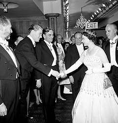 File photo dated 10/12/62 of Queen Elizabeth II arriving at the Odeon, Leicester Square, London for the world charity premiere of the film 'Lawrence of Arabia'. The Queen is wearing the same Peau De Soie taffeta dress by Norman Hartnell that was worn by Princess Beatrice at her wedding to Edoardo Mapelli Mozzi on Friday.