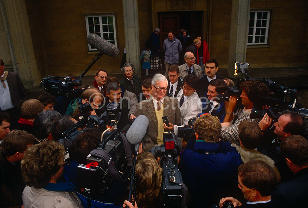 Douglas Hurd MP confronts media outside his Mid Oxfordshire constituency office during his leadership bid for the Conservative party on 23rd November 1990, at Witney England. The 1990 Conservative Party leadership election took place on 20 November 1990 following the decision of former Defence and Environment Secretary Michael Heseltine to challenge Margaret Thatcher, the incumbent Prime Minister, for leadership of the Conservative Party. Douglas Richard Hurd, Baron Hurd of Westwell, CH, CBE, PC b1930 is a British Conservative politician who served in the governments of Margaret Thatcher and John Major from 1979 to 1995.