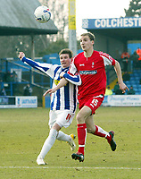 Photo: Chris Ratcliffe.<br />Colchester United v Swindon Town. Coca Cola League 1. 18/03/2006.<br />Mark Yeates (L) of Colchester tussles with Andrew Nicholas of Swindon