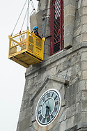 Goshen, New York - Workers upgrade cellular transmission equipment on the steeple of the Goshen First Presbyterian Chruch on April 13, 2017.