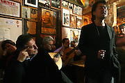 """A japanese singing Fado at """"Tasca do Chico"""". This is one of the typical spots were to see live perfomances of Fado music and were the audience can spontaneously participate and also ask to sing. It is located in  Bairro Alto neighborhood"""