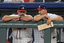 May 18, 2018 - Atlanta, GA, U.S. - ATLANTA, GA Ð MAY 18:  Atlanta coaches Sal Fasano (left) and Walt Weiss (right) talk things over in the dugout during the game between Atlanta and Miami on May 18th, 2018 at SunTrust Park in Atlanta, GA. The Miami Marlins defeated the Atlanta Braves by a score of 2 Ð 0.  (Photo by Rich von Biberstein/Icon Sportswire) (Credit Image: © Rich Von Biberstein/Icon SMI via ZUMA Press)