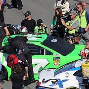 Danica Patrick, driver of the #7 GoDaddy Chevrolet prepares to climb into her race car during the 60th Annual NASCAR Daytona 500 auto race at Daytona International Speedway on Sunday, February 18, 2018 in Daytona Beach, Florida.  (Alex Menendez via AP)