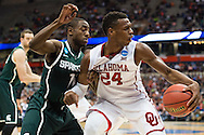 27 MAR 2015: Buddy Hield (24) of University of Oklahoma tangles with Lourawls Nairn Jr. (11) of Michigan State University during the 2015 NCAA Men's Basketball Tournament held at the Carrier Dome in Syracuse, NY. Michigan State defeated Oklahoma 62-58. Brett Wilhelm/NCAA Photos