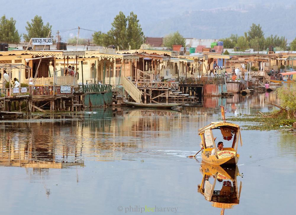 A shikara, a local wooden boat, on Lake Dal, Srinigar, Kashmir, India