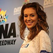 Actress Alyssa Milano is seen in the press area, prior to the NASCAR Coke Zero 400 Sprint series auto race at the Daytona International Speedway on Saturday, July 6, 2013 in Daytona Beach, Florida.  (AP Photo/Alex Menendez)