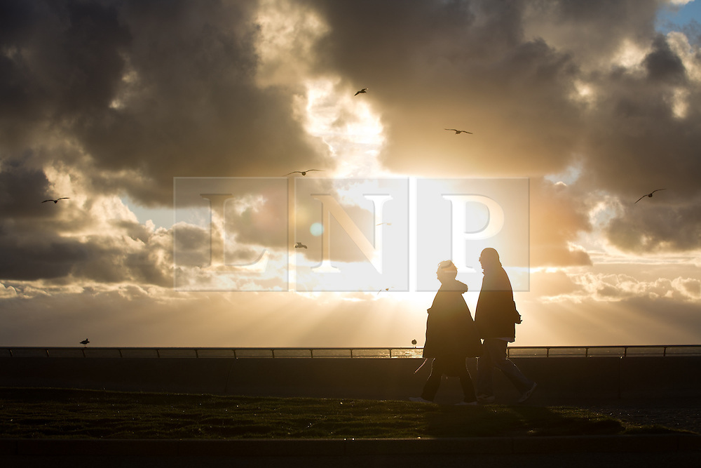 © Licensed to London News Pictures . 21/09/2015 . Blackpool , UK . Sunset at the end of a warm evening in Blackpool , as viewed from Blackpool Promenade . Photo credit: Joel Goodman/LNP