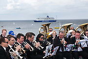 A Requiem For The Foghorn, performed by a seventy five piece brass band, a foghorn and an armada of ships playing their remote controlled foghorns.<br /> <br /> A project by Danish artist, Lise Autogena, in collaboration with Joshua Portway and composer Orlando Gough. Ships horns from an armada of vessels off-shore, seventy five brass players on-shore and the Souter Lighthouse Foghorn  performed a Foghorn Requiem, an ambitious musical performance to mark the disappearance of the sound of the foghorn from the UK's coastal landscape.