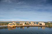 Large family island, one of the Floating islands of Lake Titicaka, Puno, Peru, South America