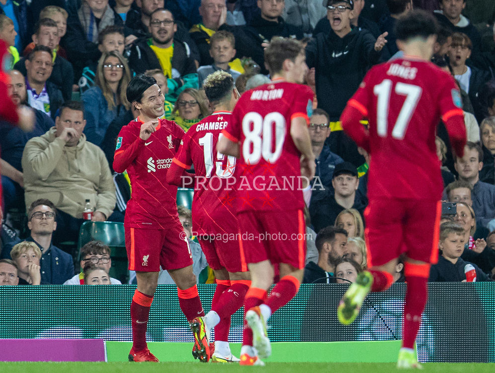 NORWICH, ENGLAND - Tuesday, September 21, 2021: Liverpool's Takumi Minamino celebrates with team-mate Alex Oxlade-Chamberlain after scoring the third goal during the Football League Cup 3rd Round match between Norwich City FC and Liverpool FC at Carrow Road. Liverpool won 3-0. (Pic by David Rawcliffe/Propaganda)