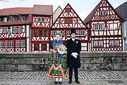 Sophia of the Volkstrachtenverein Ochsenfurt e.V.  is wearing an original traditional costume in Ochsenfurt, Lower Franconia, Germany on February 18, 2018.<br /> <br /> Groom: Thilo<br /> <br /> The original bridal dress is from around 1920, the bridal crown from around 1935 and the bridal bouquet from 1935. Sophia is wearing Biedermeier Jewelry.