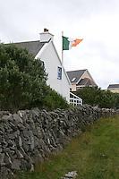 Irish flag flying on Inis Oirr the Aran Islands Galway Ireland