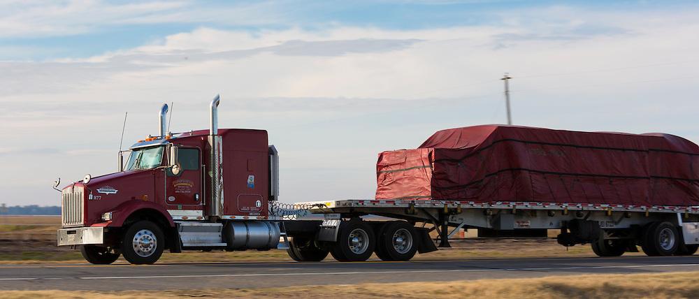 Trucker trucking along US Highway 65 route in Louisiana, USA