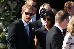 The Duke and Duchess of Sussex outside St Mary the Virgin Church in Frensham, Surrey, after attending the wedding of Charlie van Straubenzee and Daisy Jenks.