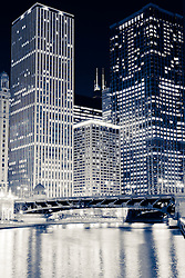 Chicago downtown loop at night along the Chicago River with the Unitrin Building, Renaissance Chicago Hotel, Leo Burnett Building and Irv Kupcinet Bridge (Wabash Avenue Bridge)