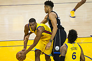 Golden State Warriors forward Kevon Looney (5) collects a loose ball against the Milwaukee Bucks at Oracle Arena in Oakland, Calif., on March 29, 2018. (Stan Olszewski/Special to S.F. Examiner)