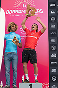 Edouard Delpero, celebrating being crowned Men's Longboard Pro Champion, with Runner Up, Frederico Nesti (ITA) at Boardmasters 2019 at Fistral Beach, Newquay, Cornwall, United Kingdom on 11 August 2019.