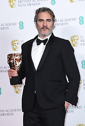 Joaquin Phoenix with his award for Best Actor at the 73rd British Academy Film Awards held at the Royal Albert Hall, London.. Photo credit should read: Doug Peters/EMPICS
