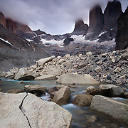 The iconic peaks of Las Torres in Torres del Paine National Park in Patagonia, Chile shrouded in clouds.