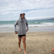 Quade Cooper with local children during the Australian teams recovery session at  Takapuna Beach at the IRB Rugby World Cup tournament, Auckland, New Zealand, 17th October 2011. Photo Tim Clayton...