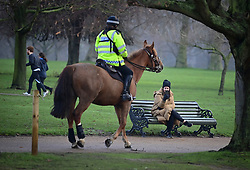 © Licensed to London News Pictures. 15/01/2021. London, UK. A police officer on horseback patrols around Hyde Park, central London. The Met police has urged Londoners to stick to lockdown rules which were introduced to fight the spread of a new, more aggressive strain of COVID-19. Photo credit: Ben Cawthra/LNP