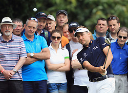 England's Ian Poulter plays a shot after his ball lands on a spectators bag on the third hole during day three of the 2017 BMW PGA Championship at Wentworth Golf Club, Surrey.