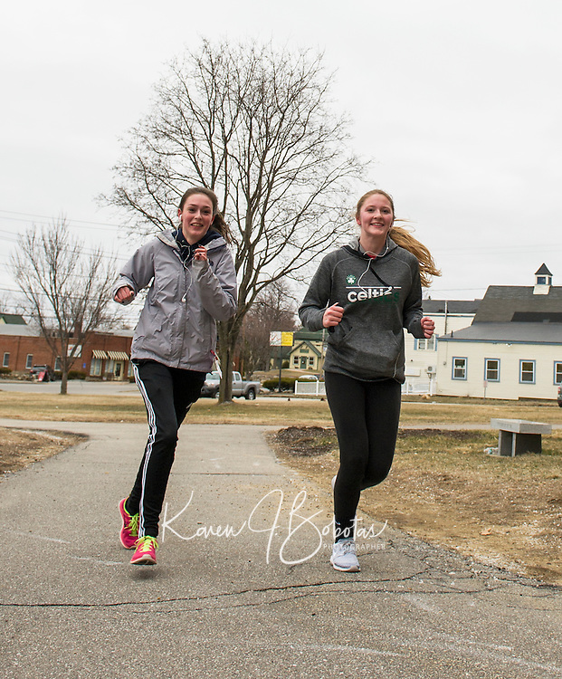 """On the path to Spring after the """"Winter that wasn't"""" for LHS girls Lacrosse players starting training with a run through Laconia Thursday afternoon.  (Karen Bobotas/for the Laconia Daily Sun)"""