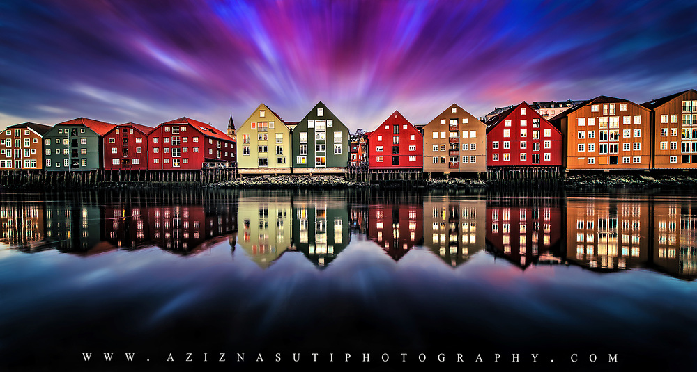 www.aziznasutiphotography.com  beautiful wooden houses of Trondheim in both side of Nidelva river is a very nice and are one of the most tourist attraction in the twon. I have plenty photos from this place but each time with a diffrent mood and sky