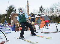 Ski Instructor Becky Bartlett loads the rope tow for Thursday night lessons at the Abenaki Ski Area in Wolfeboro.  (Karen Bobotas/for the Laconia Daily Sun)