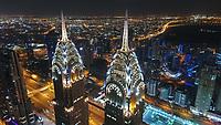 Aerial view of illuminated skyscrapers at night in Dubai, United Arab Emirates.