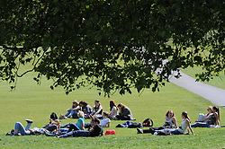 © Licensed to London News Pictures. 14/05/2014<br /> Sunny weather across London.<br /> People enjoying the sunny weather in Greenwich park,Greenwich, London today  (14.05.2014).<br /> Photo credit :Grant Falvey/LNP
