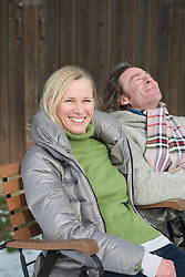 Mature couple relaxing, smiling, Bavaria, Germany