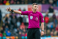 Referee Mike Oliver looks on. Premier league match, Swansea city v Leicester city at the Liberty Stadium in Swansea, South Wales on Saturday 21st October 2017.<br /> pic by Aled Llywelyn, Andrew Orchard sports photography.