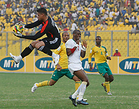 Photo: Steve Bond/Richard Lane Photography.<br />Senegal v South Africa. Africa Cup of Nations. 31/01/2008. Keeper Moneeb Josephs grabs safely in front of the advancing Henri camera (C)