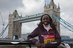 © Licensed to London News Pictures. 18/04/2013. London, England. Pictured: Kenyan Runner Edna Kiplagat. Virgin London Marathon - Photocall with International Women Runners Athletes Tiki Gelana (ETH), Edna Kiplagat (KEN), Priscah Jeptoo (KEN) and Yoko Shibui (JPN) at Tower Bridge ahead of Sunday's run, London. Photo credit: Bettina Strenske/LNP