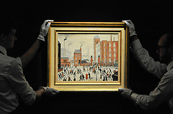 """© Licensed to London News Pictures. 17/11/2017. London, UK.  London, UK.  17 November 2017. Technicians display """"The Rush Hour"""", 1964, by L.S. Lowry (Est. GBP 0.8-1.2m).  Preview upcoming auctions of Modern & Post War British Art and Scottish Art taking place at Sotheby's, New Bond Street, on 21 and 22 November. Photo credit: Stephen Chung/LNP"""