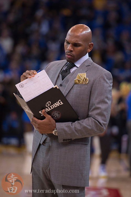 November 17, 2015; Oakland, CA, USA; Toronto Raptors assistant coach Jerry Stackhouse before the game against the Golden State Warriors at Oracle Arena. The Warriors defeated the Raptors 115-110.