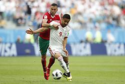 (l-r) Omid Ebrahimi of IR Iran, Hakim Ziyach of Morocco