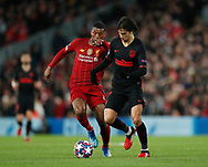 Georginio Wijnaldum of Liverpool tackles Joao Felix of Atletico Madrid during the UEFA Champions League match at Anfield, Liverpool. Picture date: 11th March 2020. Picture credit should read: Darren Staples/Sportimage