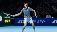 Tennis - 2019 Nitto ATP Finals at The O2 - Day One<br /> <br /> Singles Group Bjorn Borg: Roger Federer (Switzerland) vs. Dominic Thiem (Austria)<br /> <br /> Dominic Thiem (Austria) opens his frame for a forehand return <br /> <br /> COLORSPORT/DANIEL BEARHAM