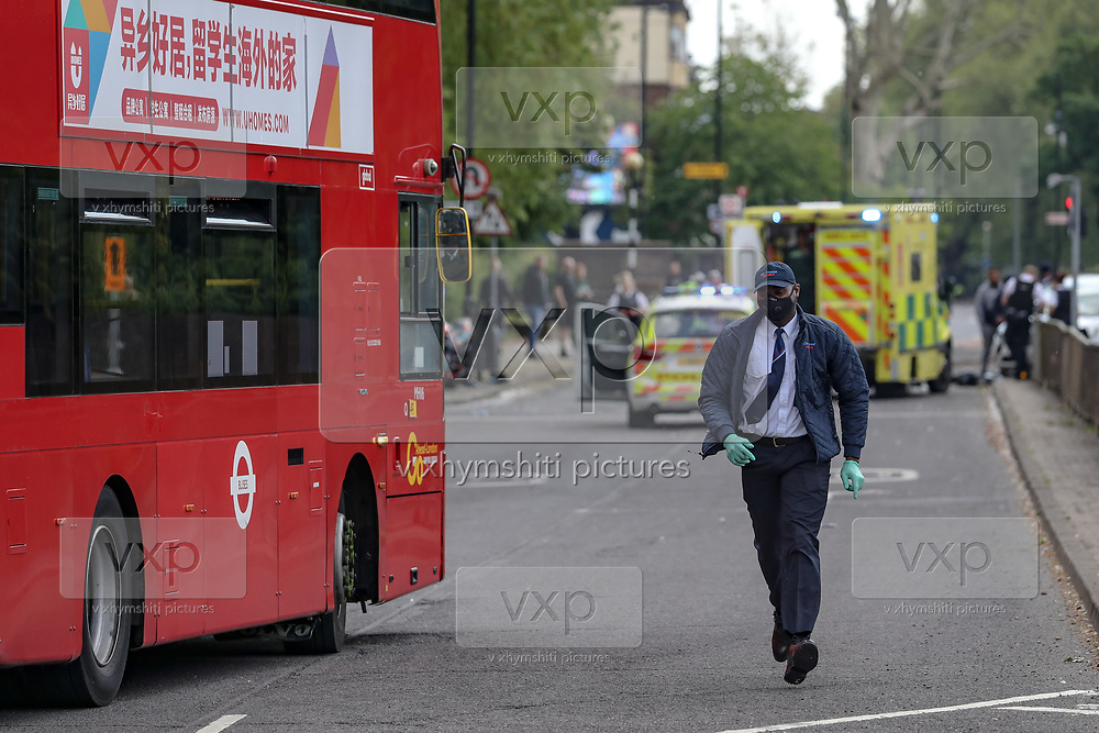 A TFL Bus 188 is seen reversing in Lower Road in London due to a road traffic accident after a motorbike and a car collided in Lower Road intersection with Neptun Street near Canada Water Station on Monday, May 4, 2020. (Photo/ Vudi Xhymshiti)