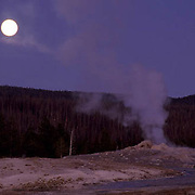 Yellowstone National Park, Moonrise over Old Faithful Geyser.