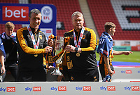 Football -  2020 / 2021 Sky Bet League One - Charlton Athletic vs Hull City - The Valley<br /> <br /> Hull City head coach Grant McCann with assistant manager Cliff Byrne lift the trophy as they celebrate their promotion from Sky Bet League One as champions.<br /> <br /> COLORSPORT