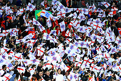 England supporters wave flags in the stands prior to the match