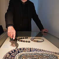 """VENICE, ITALY - DECEMBER 10: Collector Augusto Panini shows part of his collection of Ancient Venetian beads at the press preview of the exhibition """"The Adventure of Glass"""" at  Museo Correr on December 10, 2010 in Venice, Italy. After nearly thirty years Correr Museum is hosting a prestigious exhibition in celebration of over a thousands years history of glass in Venice and the Lagoon"""