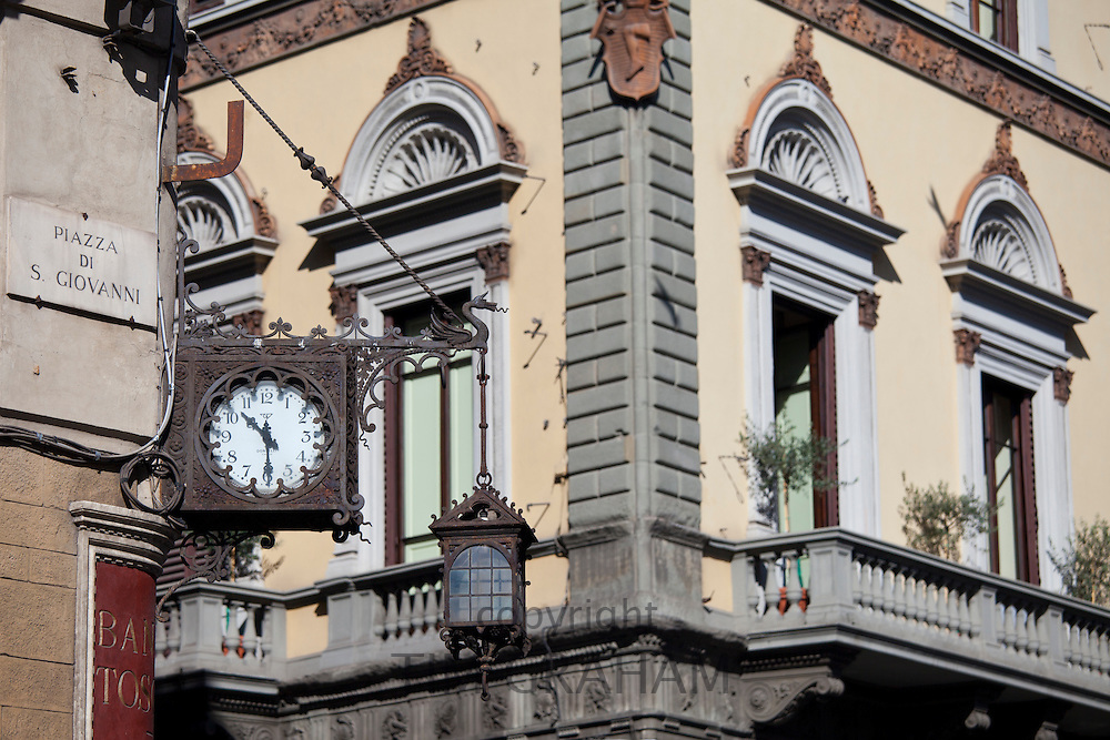Ancient clock with Roman numerals on Banca Toscana in Piazza di San Giovanni and via de Martelli in Florence, Tuscany, Italy
