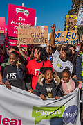 Young people lead the march - The People's Vote March For The Future demanding a Vote on any Brexit deal. The protest assembled on Park Lane and then marched to Parliament Square for speeches.
