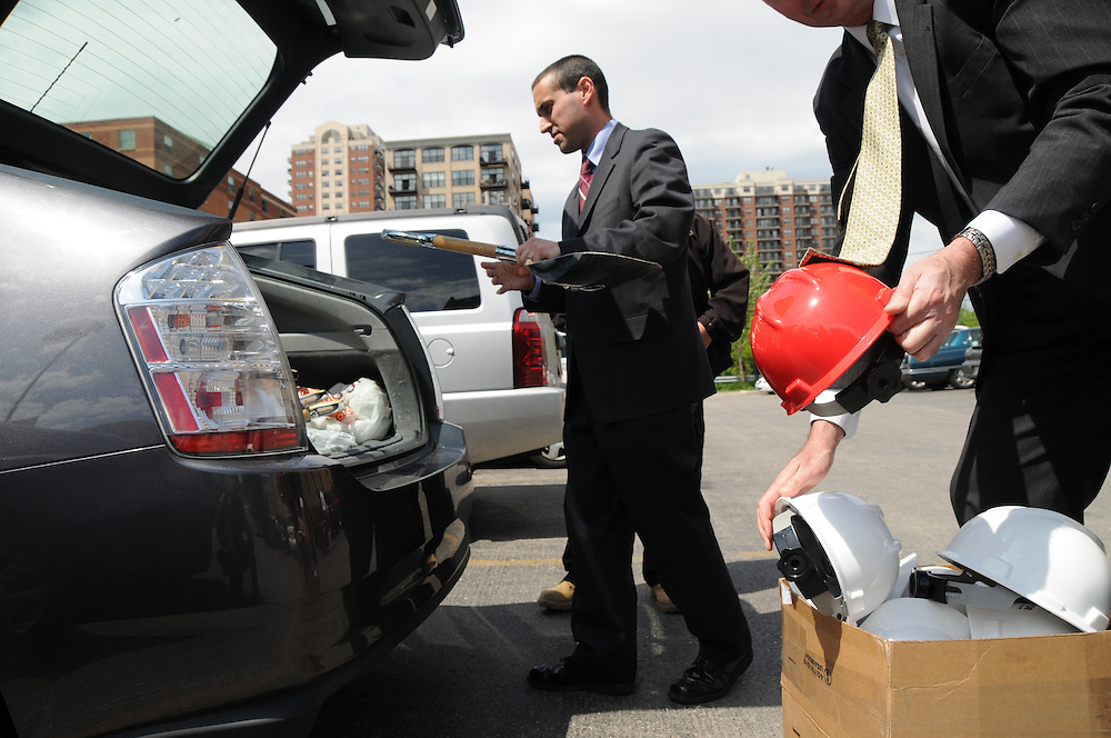 Dave Culcasi of Pepper Construction loads ceremonial shovels into a car trunk following their use during a ground breaking ceremony for an expanding Old St. Mary's Catholic School in Chicago's South Loop neighborhood.