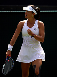 Alexandra Dulgheru reacts during her match against Venus Williams on day three of the Wimbledon Championships at the All England Lawn Tennis and Croquet Club, Wimbledon.