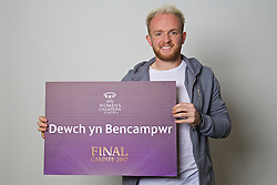 "CARDIFF, WALES - Monday, November 7, 2016: Wales' Jonathan Williams holds up a board ""Dewch yn Bencampwr"" to encourage people to become volunteers for the 2017 UEFA Champions League Final in Cardiff. (Pic by David Rawcliffe/Propaganda)"